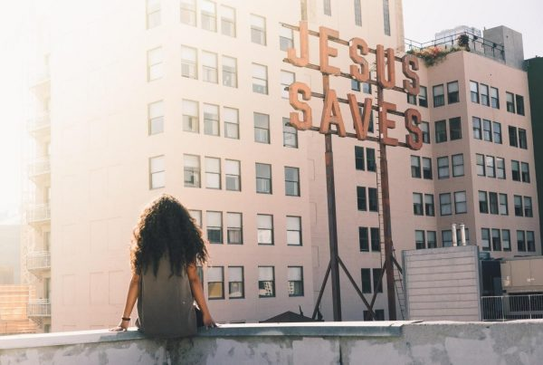 woman sitting on top of building
